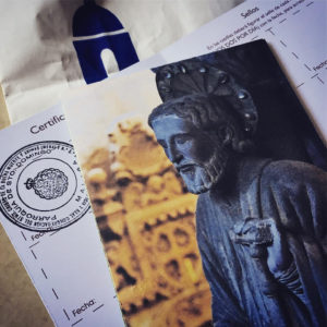Credential of the Camino with the first stamp of a pilgrim