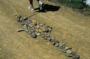 Arrow formed with stones on a path of the French Way