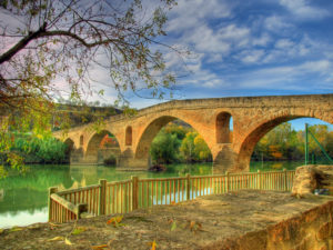 Medieval bridge over a river in Puente la Reina