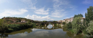 Image of the medieval bridge over a river at the exit of Puente la Reina