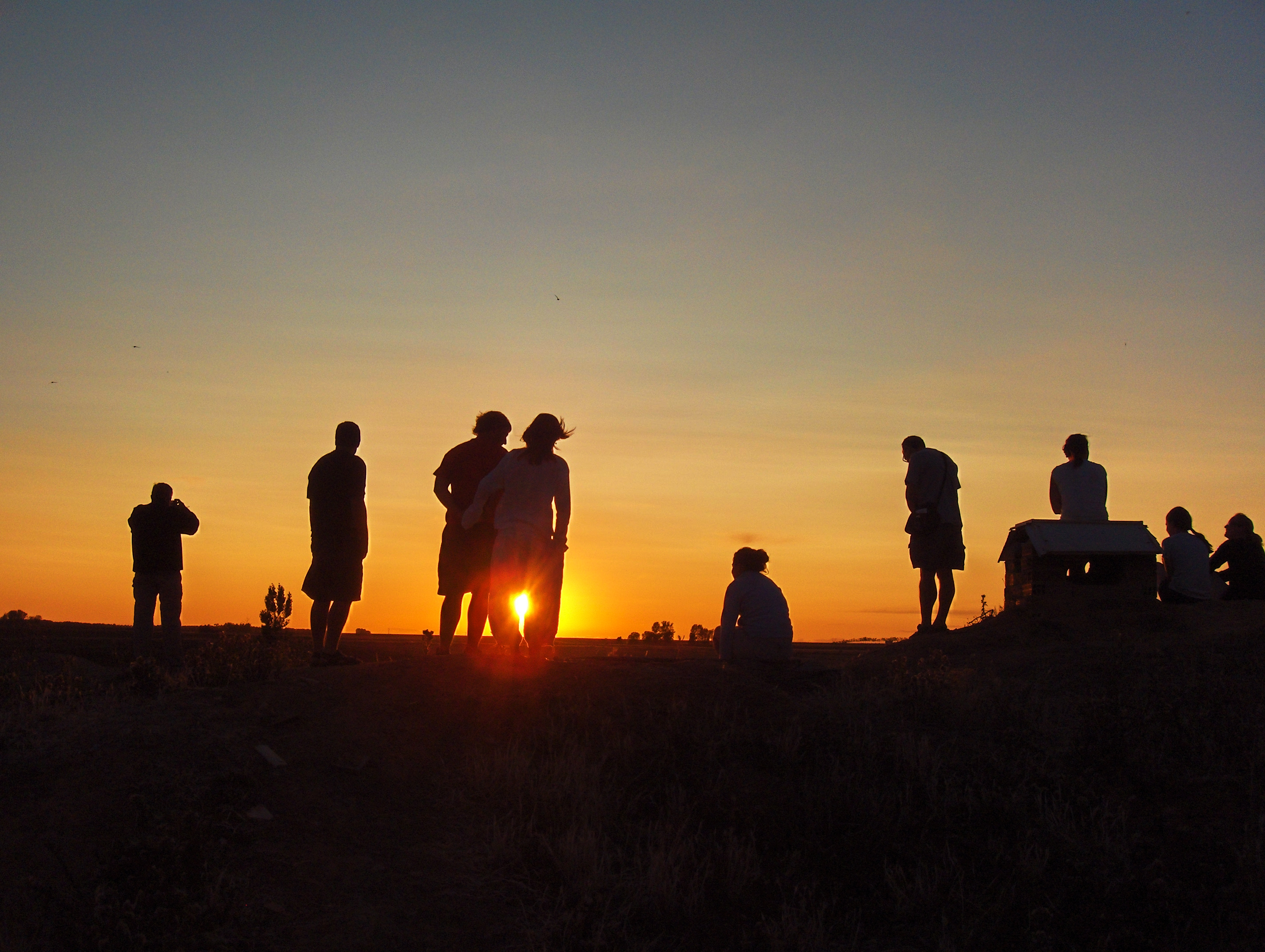 Pilgrims watching the sunset in Santiago´s Way
