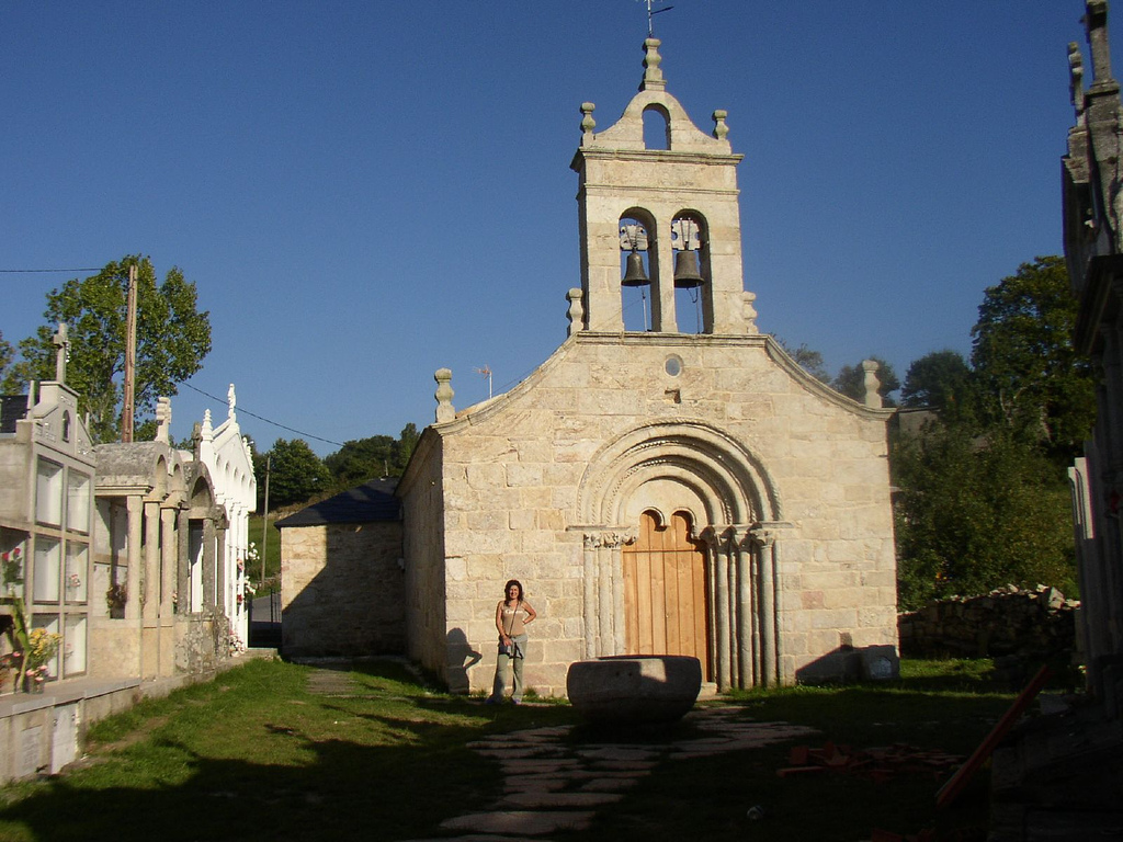 A pilgrim in the entrance to the church of Santa María de Ferreiros